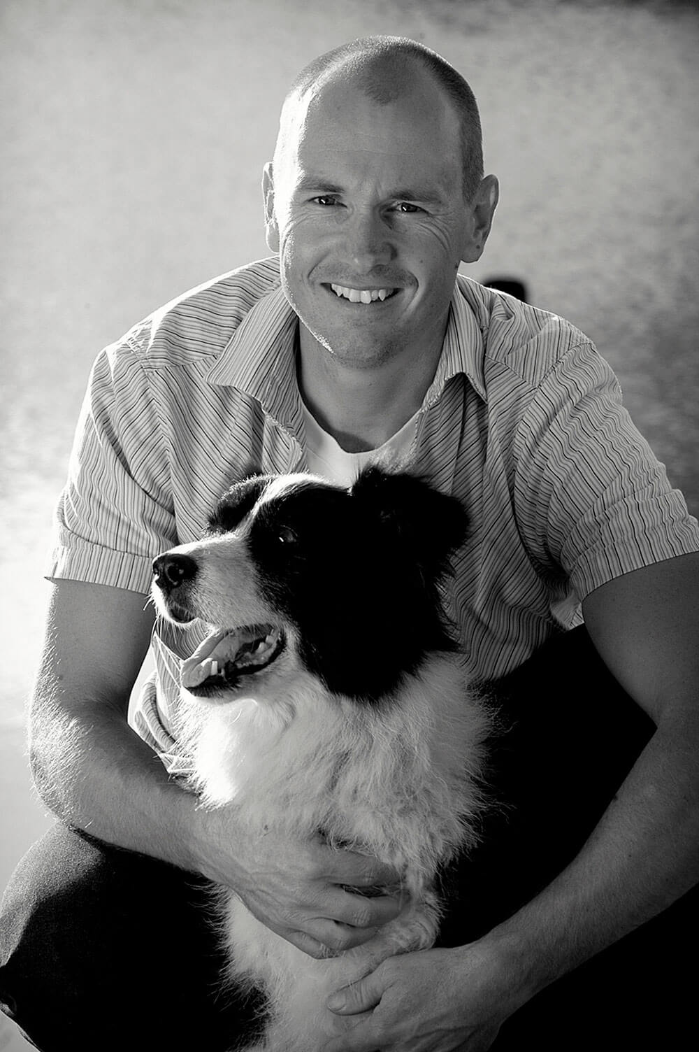 Portrait Photographer Jason embracing his dog
